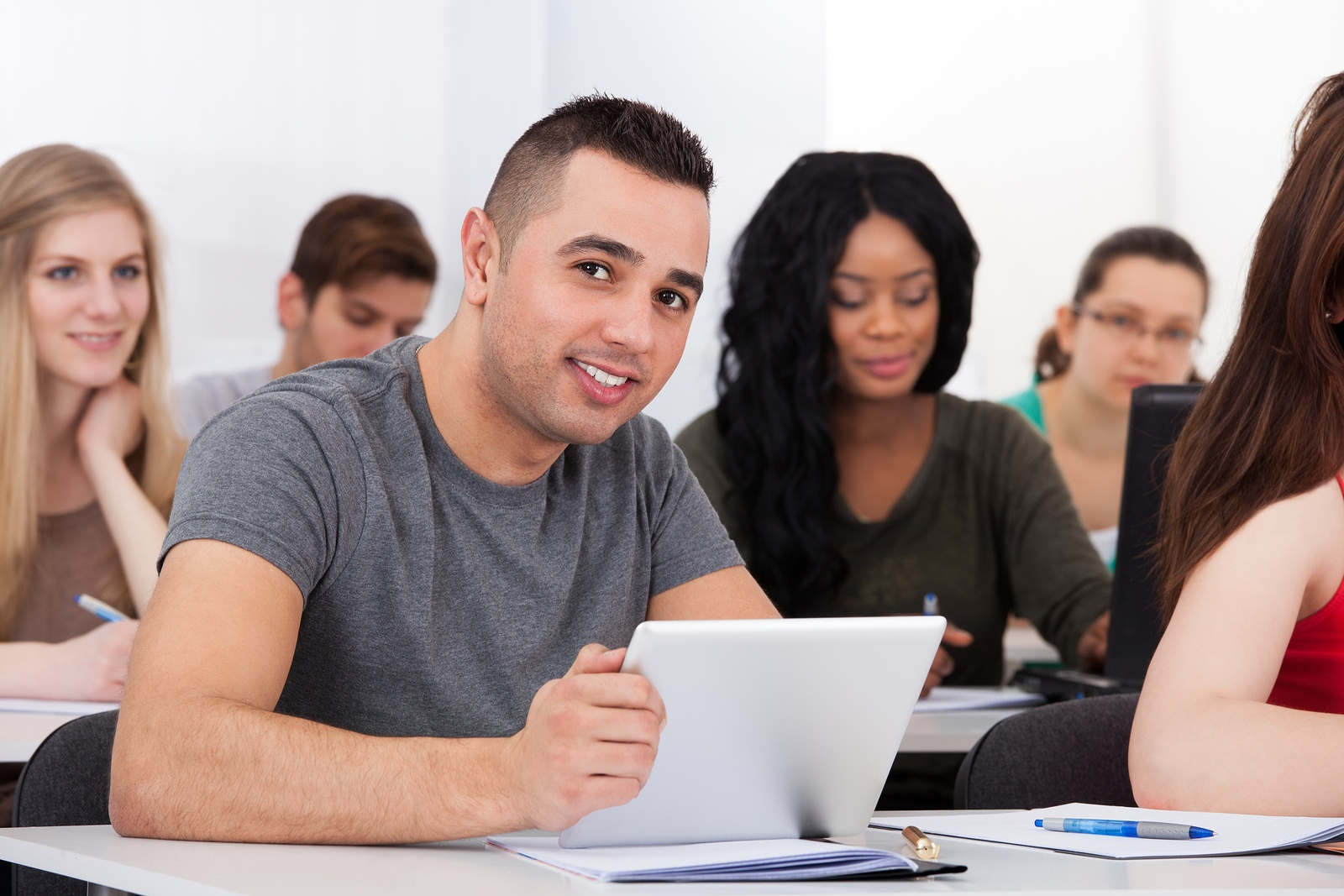 bigstock-Confident-Male-Student-Holding-72293533