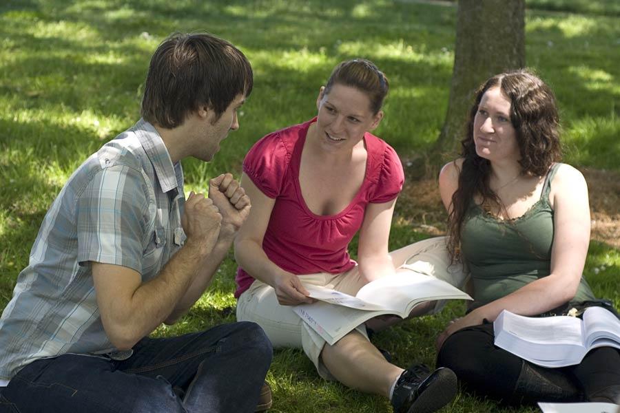 massage-school-campus-life-studying-grass